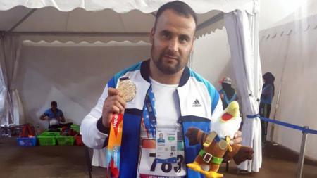 Sebuah rekor dunia kembali pecah dalam perhelatan Asian Para Games 2018. Kali ini datang dari atlet para-atletik Uzbekistan, Norbekob Khusniddin. - INDOSPORT