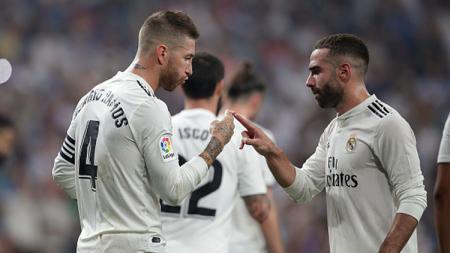 Sergio Ramos (kiri)  dan Dani Carvajal, dua bek Real Madrid. - INDOSPORT