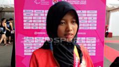 Indosport - Karisma memperoleh medali emas para atletik lari 100 M