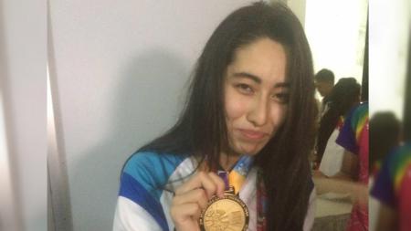 Amilova Fotimakhon, perenang Asian Para Games 2018 asal Uzbekistan yang pecahkan rekor dunia. - INDOSPORT