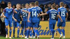 Indosport - Selebrasi para pemain Islandia usai gol ke gawang Prancis.