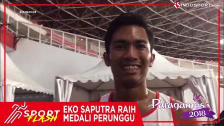 Eko Saputra, atlet penyandang disabilitas cabang olahraga Atletik di nomor 400 meter putra T12, meraih medali perunggu. - INDOSPORT