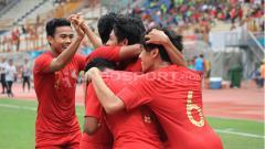 Indosport - Skuat Timnas Indonesia U-19 merayakan gol ke gawang Yordania.