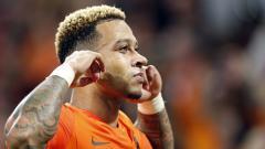 Indosport - Memphis Depay berselebrasi setelah mencetak gol ke gawang Jerman dalam laga UEFA Nations League.