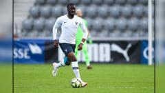 Indosport - Tanguy Ndombele, gelandang serang muda Timnas Prancis.