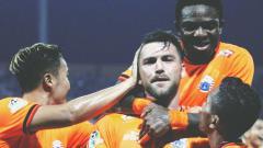 Indosport - Marko Simic berselebrasi usai mencetak gol melawan Madura United/