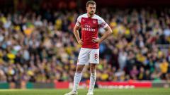 Indosport - Aaron Ramsey, gelandang serang Arsenal.