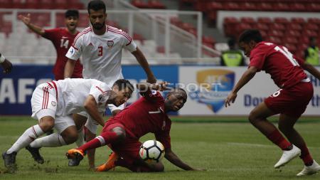 Qatar U-19 (Merah) vs UEA U-19 (Putih). - INDOSPORT