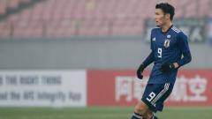 Indosport - Pemain Sagan Tosu, Ryosuke Tagawa saat berseragam Timnas Jepang.