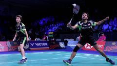 Indosport - Tontowi Ahmad/Liliyana Natsir di ajang Denmark Open 2018.