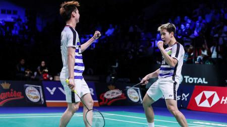 Selebrasi Kevin Sanjaya/Marcus Gideon saat menjuarai Denmark Open 2018. - INDOSPORT