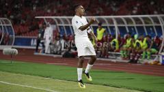 Indosport - Todd Rivaldo Ferre saat berselebrasi usai mencetak gol ke gawang Qatar U-19.