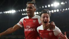 Indosport - Bintang terbuang Arsenal, Mesut Ozil ikut memanaskan suasana peperangan yang saat ini terjadi di antara Toni Kroos dan Pierre Emerick Aubameyang.