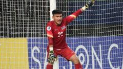 Indosport - Penjaga gawang timnas U-19 Malaysia, Azri Ghani