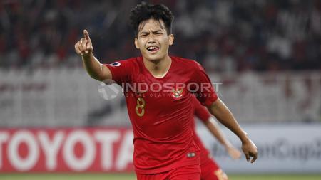 Witan Sulaeman saat berselebrasi selepas mencetak gol ke gawang UEA U-19. - INDOSPORT