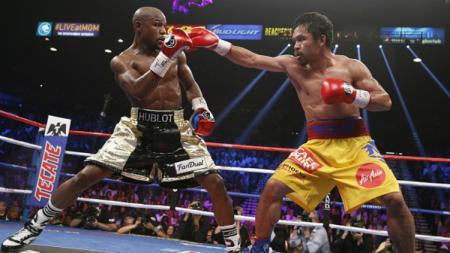 Duel tinju Floyd Mayweather vs Manny Pacquiao pada 2015 silam. - INDOSPORT
