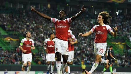 Penyerang Arsenal Welbeck usai mencetak gol ke gawang Sporting Lisbon. - INDOSPORT