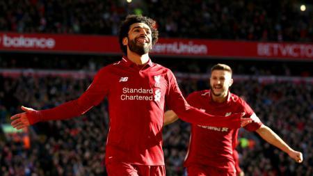 Selebrasi pemain Liverpool Mohamed Salah usia mencetak gol ke gawang Cardiff City, Minggu (27/10/18). - INDOSPORT