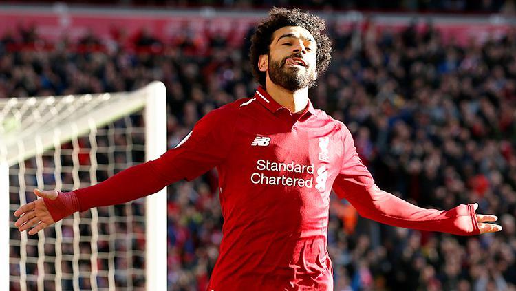 Mohamed Salah berselebrasi seusai mencetak gol ke gawang Cardiff City. Copyright: Getty Images/Jan Kruger
