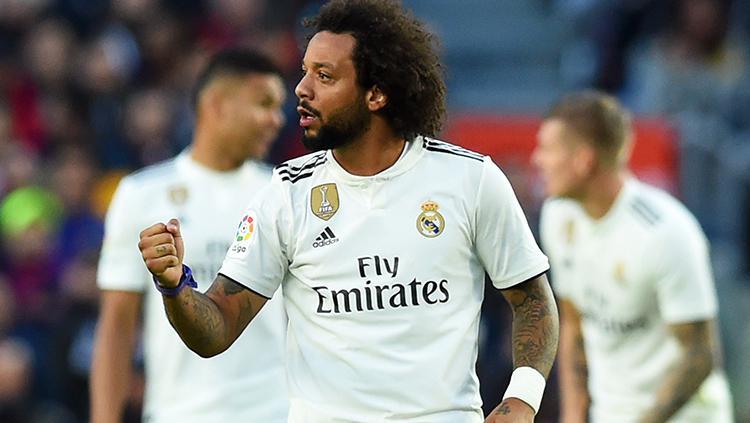 Marcelo berselebrasi usai mencetak gol ke gawang Barcelona di pekan ke-10 La Liga 2018/19. Copyright: Getty Images/Alex Caparros