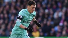 Indosport - Mesut Ozil sempat terlihat sebal ketika ditarik keluar oleh Unai Emery