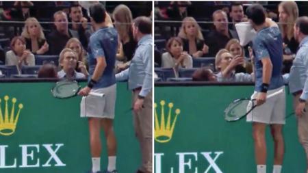 Novak Djokovic menghampiri penonton yang sakit. - INDOSPORT