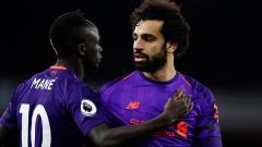 Indosport - Sadio Mane dan Mohamed Salah, dua dari tiga pemain peraih top skorer Liga Primer Inggris 2018/19.