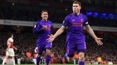 Indosport - James Milner berselebrasi usai mencetak gol ke gawang Arsenal.