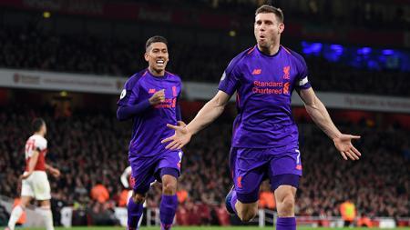 James Milner berselebrasi usai mencetak gol ke gawang Arsenal. - INDOSPORT