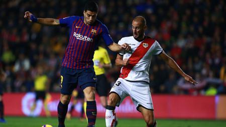 Luis Suarez menggiring bola. - INDOSPORT