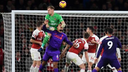 Bernd Leno (hijau) saat Arsenal melawan Liverpool - INDOSPORT