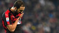 Indosport - Gonzalo Higuain saat tampil membela AC Milan melawan Udinese.