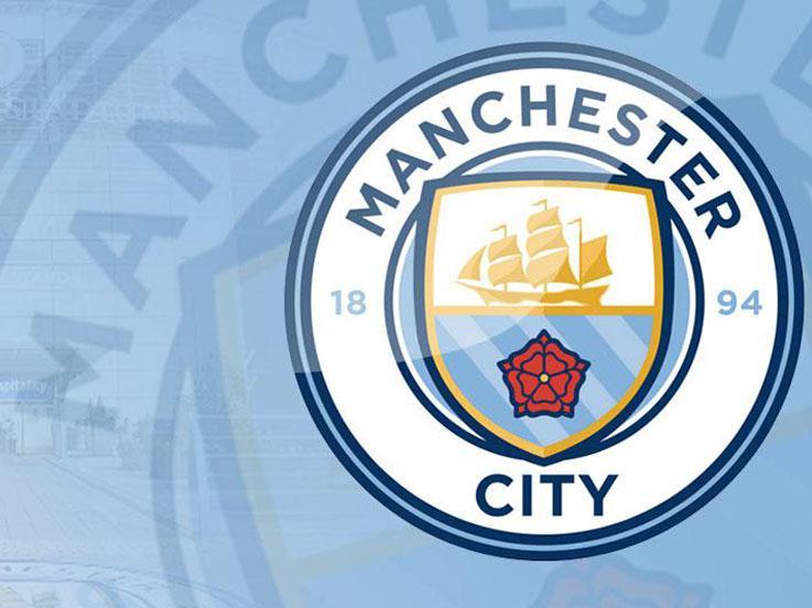 Logo Manchester City. Copyright: Suhaeli/INDOSPORT/ISTIMEWA