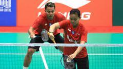 Indosport - Pasangan ganda campuran nasional, Rehan Naufal Kusharjanto/Siti Fadia Silva Ramadhanti dalam aksinya di ajang BWF World Junior Championships 2018