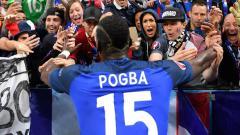 Indosport - Paul Pogba disambut hangat oleh fans