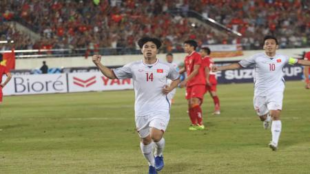 Selebrasi pemain Vietnam usai cetak gol ke gawang Laos. - INDOSPORT