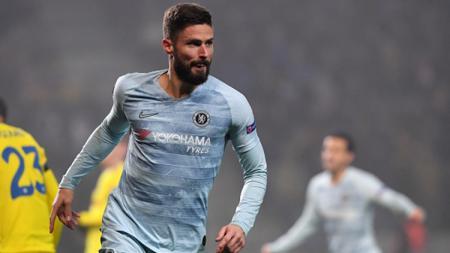 Olivier Giroud berselebrasi usai mencetak gol ke gawang BATE. - INDOSPORT