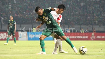 Sedikitnya ada 5 pemain sepak bola yang pernah membela klub Liga 1 2019 antara Persebaya Surabaya dan PSM Makassar. - INDOSPORT