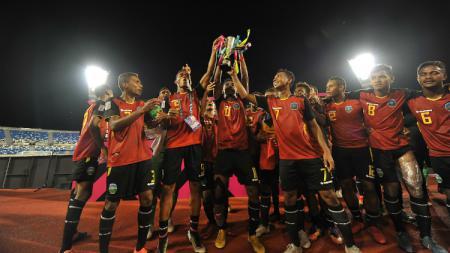 Timnas Timor Leste saat merayakan juara. - INDOSPORT