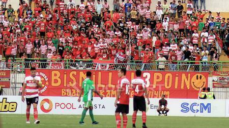 Berikut tersaji hasil pertandingan sepak bola Shopee Liga 1 Indonesia 2019 antara Madura United vs Bhayangkara FC, dimana tim tamu mampu menang 2-1. - INDOSPORT