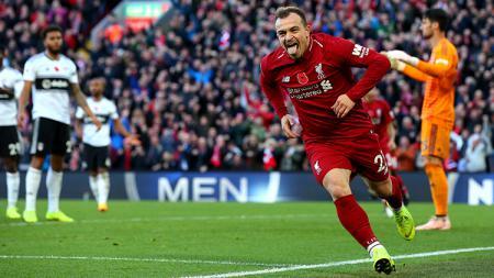 Selebrasi Xherdan Shaqiri saat mencetak gol kedua untuk Liverpool ke gawang Fulham. - INDOSPORT
