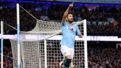 Indosport - Ilkay Gundogan berselebrasi usai mencetak gol ke gawang Man United.