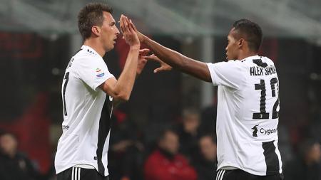 Mandzukic berselebrasi usai mencetak gol ke gawang AC Milan. - INDOSPORT