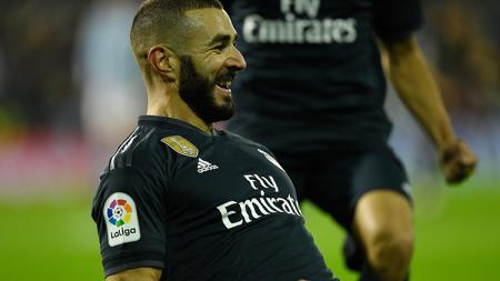 Karim Benzema berselebrasi usai mencetak gol ke gawang Celta Vigo. - INDOSPORT