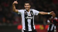 Indosport - Cristiano Ronaldo berselebrasi usai mencetak gol ke gawang AC Milan.
