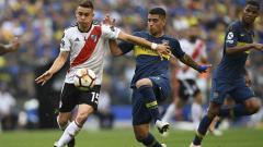 Indosport - Boca Juniors dan River Plate memang dikenal sebagai klub sepak bola yang memiliki rivalitas tinggi.