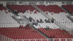 Indosport - Suporter Indonesia masih terlihat sepi.