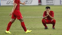 Indosport - M. Hargianto tampak melepas lelah usai meladeni perlawanan Timor Leste.