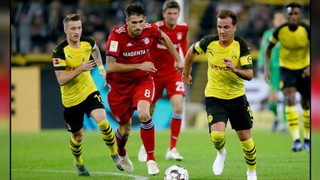 Jadwal pertandingan sepak bola bertajuk Piala Super Jerman antara Borussia Dortmund vs Bayern Munchen bakal tersaji pada Minggu (04/08/19) 01.30 dini hari. - INDOSPORT