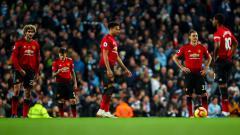 Indosport - Para pemain Manchester United tertunduk lesu usai dihempaskan oleh Manchester City pada akhir pekan kemarin.